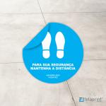 """Autocolante chão azul """"Mantenha a distância""""."""